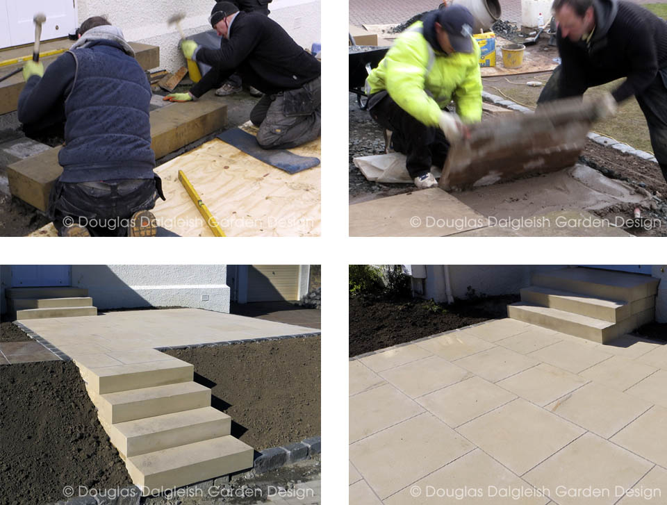 stonemasons building sandstone steps and laying garden paving