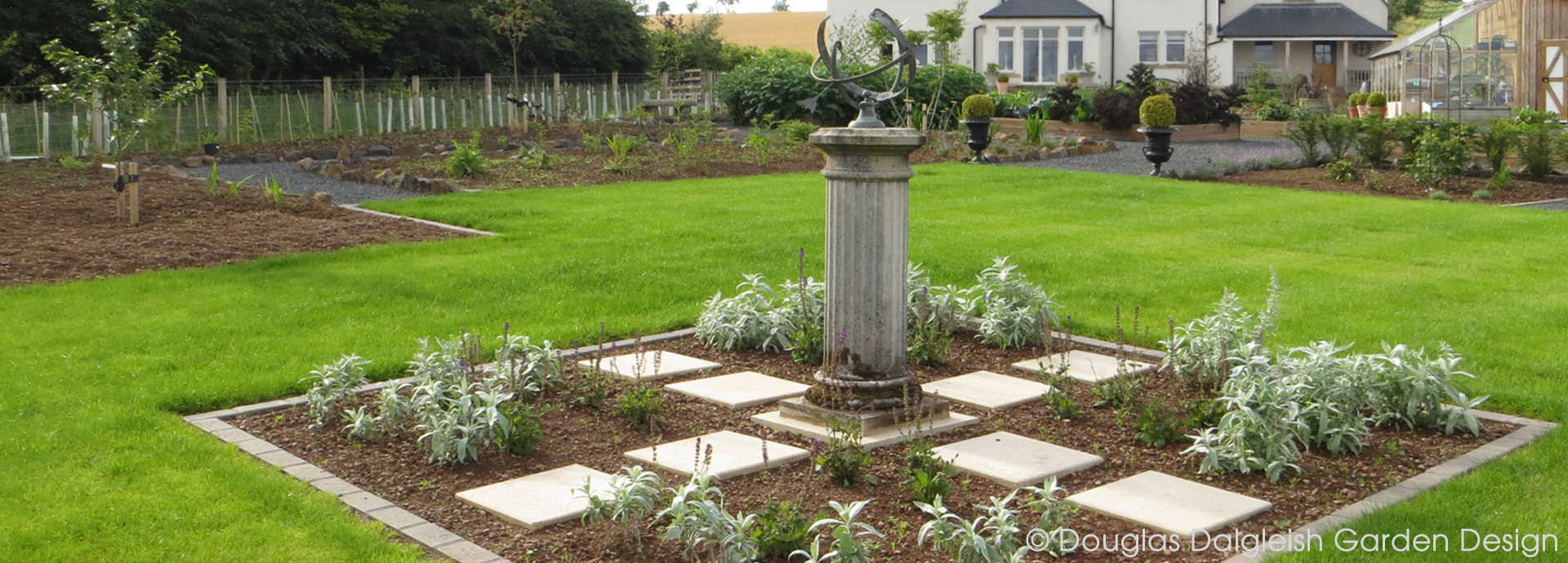 garden sundial in new lawn area