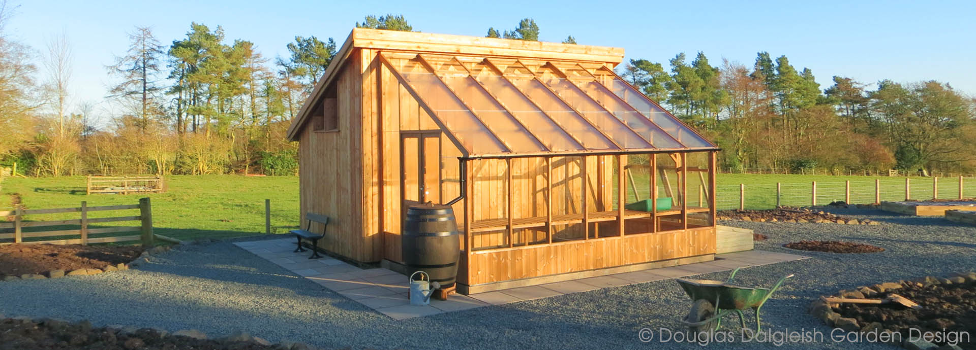 bespoke larch shed and Thermowood® greenhouse
